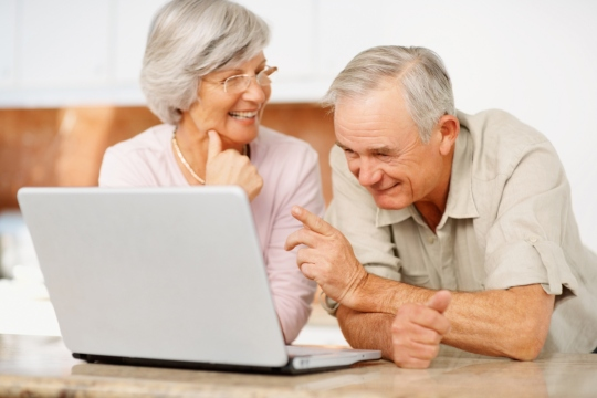 senior-man-and-woman-using-a-computer-laptop