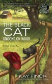 the black cat knocks