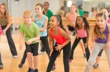 Diverse group of children in a dance fitness class