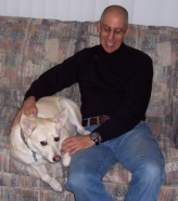 Phil Klein with a white dog